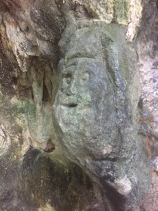 face carved into cave wall